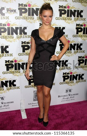 "LOS ANGELES - OCT 11:  Caitlin O'Connor arrives at the ""Mr. Pink"" Energy Drink Launch at Beverly Wilshire Hotel on October 11, 2012 in Beverly Hills, CA - stock photo"