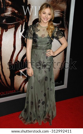 LOS ANGELES - OCT 7:  Chloe Grace Moretz arrives at the Carrie World Premiere   on October 7, 2013 in Hollywood, CA