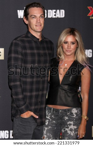 "LOS ANGELES - OCT 2:  Christopher French, Ashley Tisdale at the ""The Walking Dead"" Season 5 Premiere at Universal City Walk on October 2, 2014 in Los Angeles, CA - stock photo"