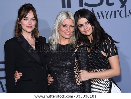 LOS ANGELES - OCT 26:  Dakota Johnson, Kate Young & Selena Gomez arrives to the InStyle Awards 2015  on October 26, 2015 in Hollywood, CA.                 - stock photo