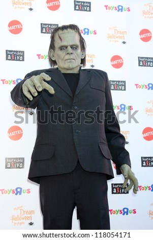 "LOS ANGELES - OCT 27:  Frankenstein Costume arrives at ""Keep A Child Alive Presents 2012 Dream Halloween Los Angeles"" at Barker Hanger on October 27, 2012 in Santa Monica, CA - stock photo"