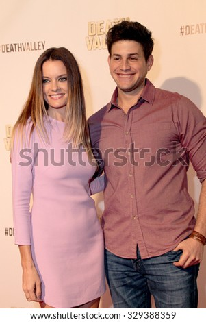 """LOS ANGELES- OCT 17: Gina Holden and David Blue arrive at the """"Death Valley"""" film premiere Oct. 17, 2015 at Raleigh Studios in Los Angeles, CA. - stock photo"""