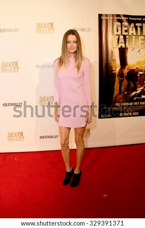 """LOS ANGELES- OCT 17: Gina Holden arrives at the """"Death Valley"""" film premiere Oct. 17, 2015 at Raleigh Studios in Los Angeles, CA. - stock photo"""