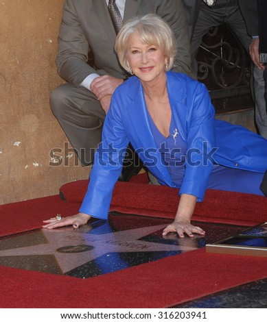 LOS ANGELES - OCT 4:  Helen Mirren arrives at the Helen Mirren Star On The Hollywood Walk Of Fame Ceremony  on January 3, 2013 in Los Angeles, CA              - stock photo