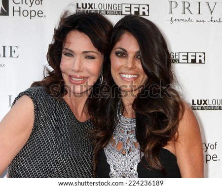 """LOS ANGELES - OCT 15:  Hunter Tylo, Lindsay Hartley at the Sue Wong """"Fairies and Sirens"""" Fashion Show at The REEF on October 15, 2014 in Los Angeles, CA - stock photo"""