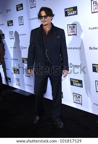 "LOS ANGELES - OCT 13:  Johnny Depp arrives to the ""Rum Diary"" World Premiere  on October 13, 2011 in Los Angeles, CA - stock photo"