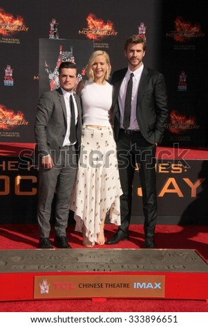 LOS ANGELES - OCT 31:  Josh Hutcherson, Jennifer Lawrence, Liam Hemsworth at the Hunger Games Handprint and Footprint Ceremony at the TCL Chinese Theater on October 31, 2015 in Los Angeles, CA - stock photo