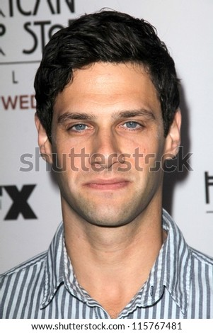"""LOS ANGELES - OCT 13:  Justin Bartha arrives at the """"American Horror Story: Asylum"""" Premiere Screening at Paramount Theater on October 13, 2012 in Los Angeles, CA - stock photo"""