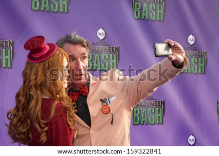 LOS ANGELES - OCT 20:  Katherine McNamara, Bill Nye at the Hub Network First Annual Halloween Bash at Barker Hanger on October 20, 2013 in Santa Monica, CA - stock photo