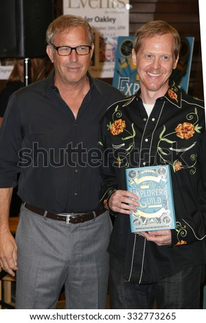 """LOS ANGELES - OCT 27:  Kevin Costner, Rick Ross at the Kevin Costner Signs """"The Explorers Guild: Volume One"""" at the Barnes and Noble on October 24, 2015 in Los Angeles, CA - stock photo"""