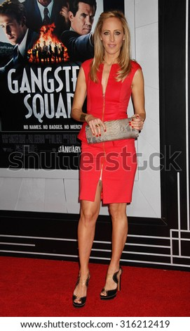LOS ANGELES - OCT 4:  Kim Raver arrives at the Gangster Squad World Premiere  on January 7, 2013 in Hollywood, CA              - stock photo