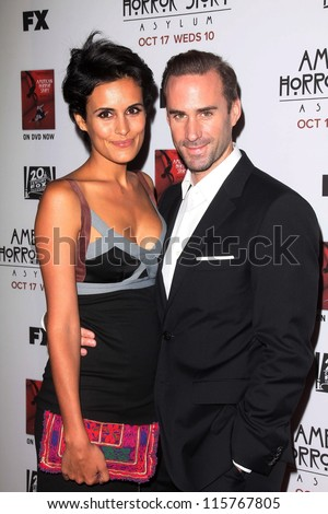 "LOS ANGELES - OCT 13:  Maria Dolores Dieguez, Joseph Fiennes arrives at the ""American Horror Story: Asylum"" Premiere Screening at Paramount Theater on October 13, 2012 in Los Angeles, CA - stock photo"