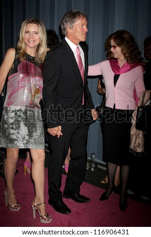 "LOS ANGELES - OCT 26:  Michelle Pfeiffer, David E. Kelley arrives at ""The Pink Party '12"" at Hanger 8 on October 26, 2012 in Santa Monica, CA - stock photo"