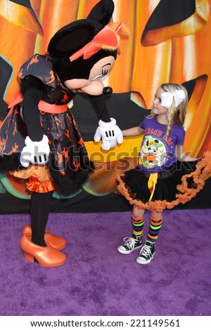LOS ANGELES - OCT 1:  Minnie Mouse, McKenna Grace at the VIP Disney Halloween Event at Disney Consumer Product Pop Up Store on October 1, 2014 in Glendale, CA - stock photo