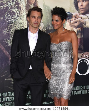 "LOS ANGELES - OCT 24:  Olivier Martinez & Halle Berry arriving to ""Cloud Atlas"" Los Angeles Premiere  on October 24, 2012 in Hollywood, CA - stock photo"