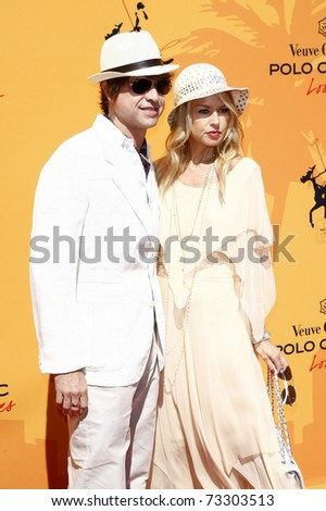 LOS ANGELES - OCT 10:  Rachel Zoe and husband Rodger Berman arriving at the Veuve Cliquot Polo Classic Los Angeles at Will Rogers Park, Los Angeles, California on October 10,  2010.