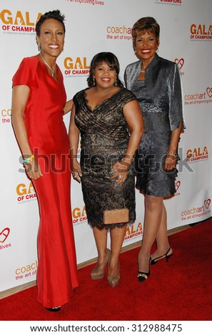 LOS ANGELES - OCT 17:  Robin Roberts, Chandra Wilson and Sally-Ann Roberts arrives at the CoachArt 2013 Gala of Champions  on October 17, 2013 in Beverly Hills, CA                 - stock photo