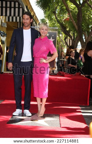 LOS ANGELES - OCT 29:  Ryan Sweeting, Kaley Cuoco at the Kaley Cuoco Honored With Star On The Hollywood Walk Of Fame at the Hollywood Blvd. on October 29, 2014 in Los Angeles, CA - stock photo
