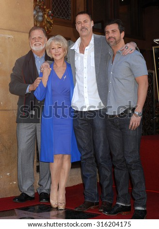 LOS ANGELES - OCT 4:  Taylor Hackford, wife Helen Mirren, sons Rio, Alexander arrive at the Helen Mirren Star On The Hollywood Walk Of Fame Ceremony  on January 3, 2013 in Los Angeles, CA              - stock photo