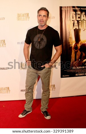 """LOS ANGELES- OCT 17: Victgor Webster arrives at the """"Death Valley"""" film premiere Oct. 17, 2015 at Raleigh Studios in Los Angeles, CA. - stock photo"""