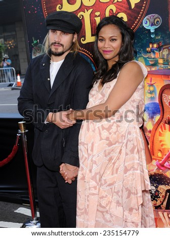 "LOS ANGELES - OCT 12:  Zoe Saldana & Marco Perego arrives to the ""The Book of Life"" Los Angeles Premiere on October 12, 2014 in Los Angeles, CA                 - stock photo"