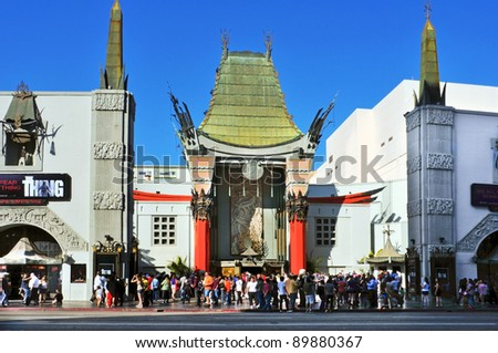 LOS ANGELES - OCTOBER 16: Grauman's Chinese Theatre on October 16, 2011 in Los Angeles, CA. There are nearly 200 Hollywood celebrity handprints, footprints and autographs in the concrete of its forecourt - stock photo