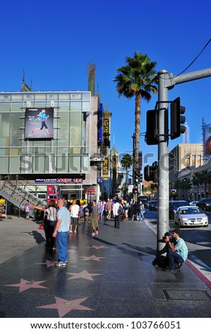 LOS ANGELES - OCTOBER 16: Hollywood Walk of Fame in Hollywood Boulevard on October 16, 2011 in Los Angeles. Those more than 2,400 five-pointed stars attracts about 10 million visitors annually - stock photo