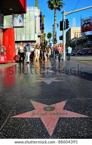 LOS ANGELES - OCTOBER 16: Hollywood Walk of Fame in Hollywood Boulevard on October 16, 2011 in Los Angeles. Those more than 2,400 five-pointed stars attracts about 10 million visitors annually