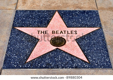 LOS ANGELES - OCTOBER 16: The Beatles star in Hollywood Walk of Fame on October 16, 2011 in Los Angeles, CA. There are more than 2,400 five-pointed stars attracts about 10 million visitors annually - stock photo