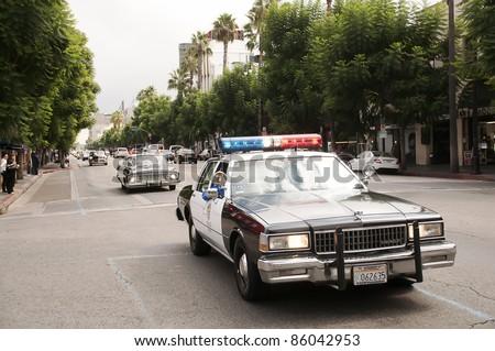 LOS ANGELES - OCTOBER 4: Vintage Police Car Parade in Hollywood on October 4, 2011 in Los Angeles, CA. - stock photo