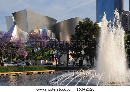 Los Angeles Philharmonic Orchestra venue with jacaranda trees and fountain in foreground - stock photo
