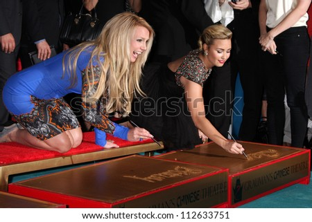 LOS ANGELES - SEP 11:  Britney Spears, Demi Lovato at the FOX  X-Factor Judges Handprint Ceremony at Graumans Chinese Theater on September 11, 2012 in Los Angeles, CA - stock photo
