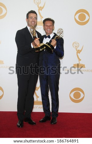 LOS ANGELES - SEP 22: Carson Daly, Mark Burnett in the press room during the 65th Annual Primetime Emmy Awards held at Nokia Theater L.A. Live on September 22, 2013 in Los Angeles, California - stock photo