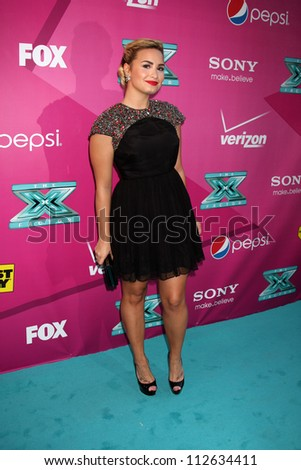 LOS ANGELES - SEP 11:  Demi Lovato arrives at the FOX Season 2 Premiere of X-Factor at Graumans Chinese Theater on September 11, 2012 in Los Angeles, CA - stock photo