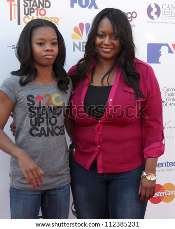 LOS ANGELES - SEP 7:  Gabby Douglas, Natalie Hawkins arrives at the 2012 Stand Up To Cancer Benefit at Shrine on September 7, 2012 in Los Angeles, CA