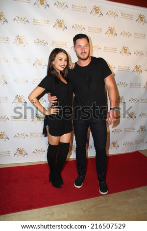 LOS ANGELES - SEP 10:  Janel Parrish, Val Chmerkovskiy at the Dance With Me USA Grand Opening at Dance With Me Studio on September 10, 2014 in Sherman Oaks, CA - stock photo