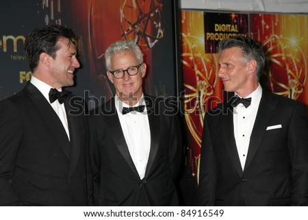 LOS ANGELES - SEP 18:  Jon Hamm, John Slatterly, Christopher Stanley in the Press Room at the 63rd Primetime Emmy Awards at Nokia Theater on September 18, 2011 in Los Angeles, CA