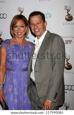 LOS ANGELES - SEP 21:  Lisa Joyner, Jon Cryer arrives at the Primetime Emmys Performers Nominee Reception at Spectra by Wolfgang Puck on September 21, 2012 in Los Angeles, CA - stock photo