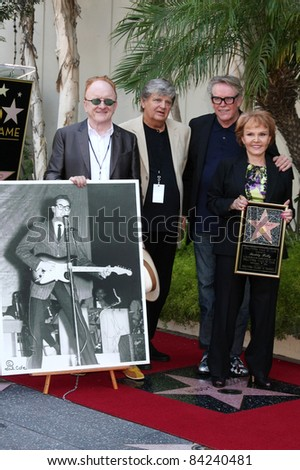 LOS ANGELES - SEP 7:  Peter Asher, Phil Everly, Gary Busey, Maria Elena Holly at a ceremony where Buddy Holly is honored with a star on the Walk of Fame in Los Angeles, California on September 7, 2011 - stock photo