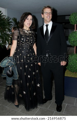 LOS ANGELES - SEP 12:  Phil Laak, Jennifer Tilly at the Mercy For Animals 15th Anniversary Gala  at London Hotel on September 12, 2014 in West Hollywood, CA - stock photo