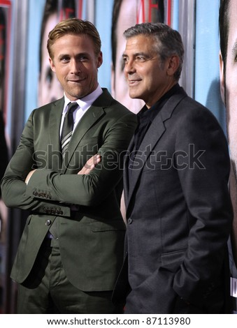 "LOS ANGELES - SEP 27:  Ryan Gosling & George Clooney arrives to the ""The Ides of March"" Los Angeles Premiere  on September 27,2011 in Beverly Hills, CA"