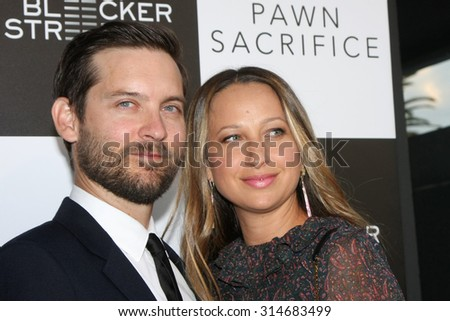 """LOS ANGELES - SEP 8:  Tobey Maguire, Jennifer Meyer at the """"Pawn Sacrifice"""" LA Premiere at the Writer's Guild Theater on September 8, 2015 in Beverly Hills, CA - stock photo"""
