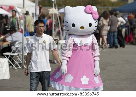 LOS ANGELES - SEPT 25:  A festival participant dressed as 'Hello Kitty' at Little Tokyo's Cherry Blossom Festival on September 25, 2011 in Los Angeles, CA. - stock photo