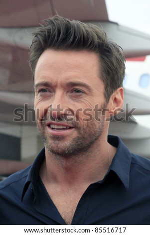 LOS ANGELES - SEPT 23:  Hugh Jackman arrives as Virgin America unveils new DreamWorks 'Reel Steel' plane at LAX Airport on September 23, 2011 in Los Angeles, CA - stock photo