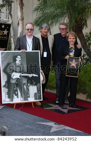 LOS ANGELES - SEPT 7: Peter Asher, Phil Everly, Gary Busey, Maria Elena Holly at the Buddy Holly Walk of Fame Ceremony at the Hollywood Walk of Fame on September 7, 2011 in Los Angeles, CA - stock photo