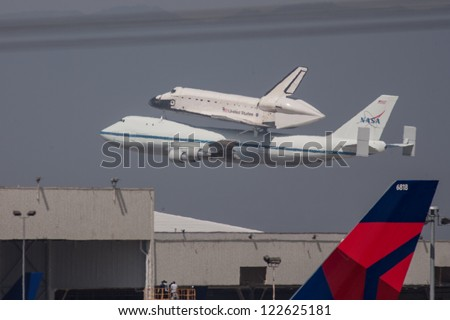LOS ANGELES - SEPT 21: Shuttle Endeavour atop the Shuttle Carrier Aircraft flies over Los Angles on Sept 21, 2012.