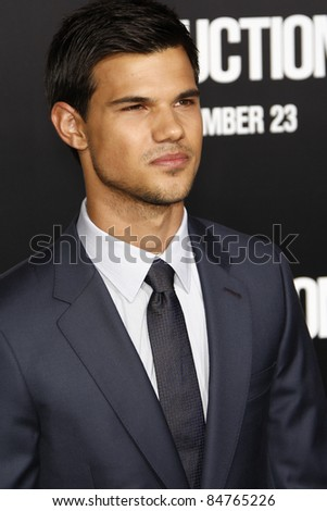 "LOS ANGELES - SEPT 15:  Taylor Lautner arriving at the ""Abduction"" Premiere at Grauman's Chinese Theater on September 15, 2011 in Los Angeles, CA - stock photo"