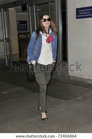 LOS ANGELES - SEPTEMBER 24: Actress Anne Hathaway is seen at LAX . September 13, 2010 in Los Angeles, California