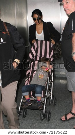 LOS ANGELES - SEPTEMBER 5: Actress Salma Hayek with daughter at LAX . September 5th 2010 in Los Angeles, California