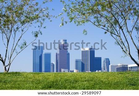 Los Angeles skyline against blue sky background. - stock photo